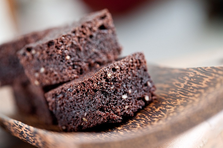 Plate of delicious sliced chocolate brownies.